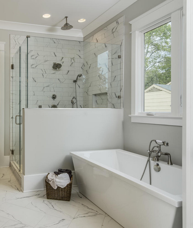 Bathroom marble floor tile and marble shower tile. Using the same tile on the floor and on the shower walls, and by just changing their size, helps to create a seamless feel in this space. Bathroom marble floor tile and marble shower tile. Bathroom marble floor tile and marble shower tile #Bathroom #marblefloortile #bathroommarblefloortile #marbleshowertile #showertile Domaine Development