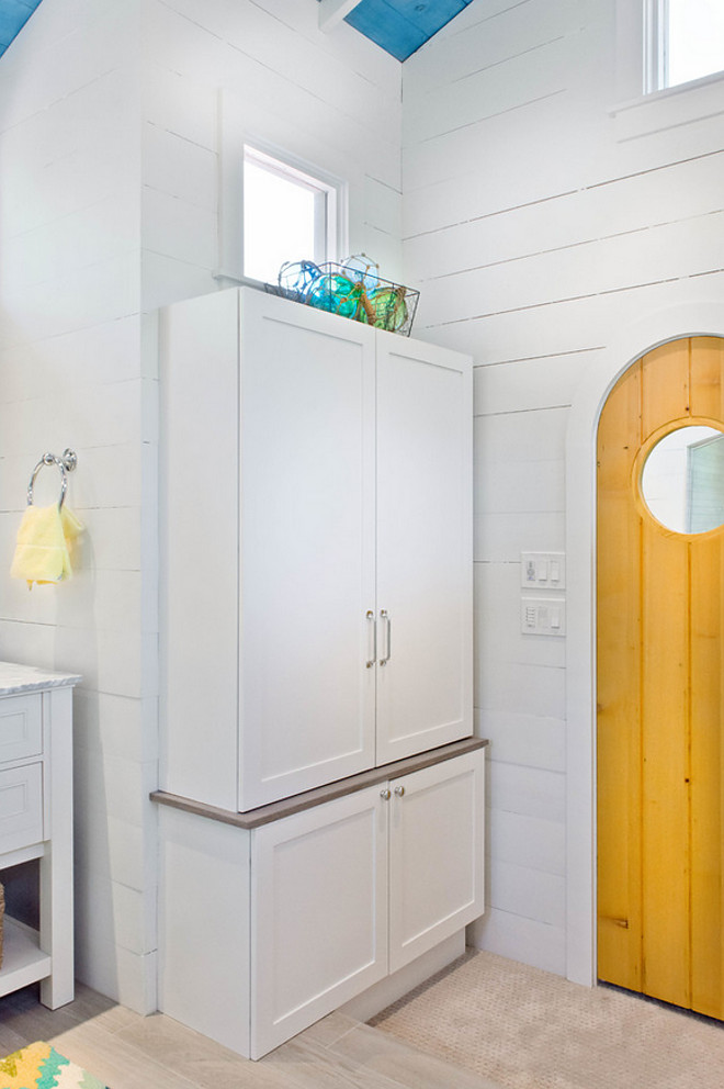Bathroom shiplap. Bathroom linen cabinet and shiplap walls.Accents of turquoise and yellow create a happy atmosphere #shiplap #cabinet Younique Designs