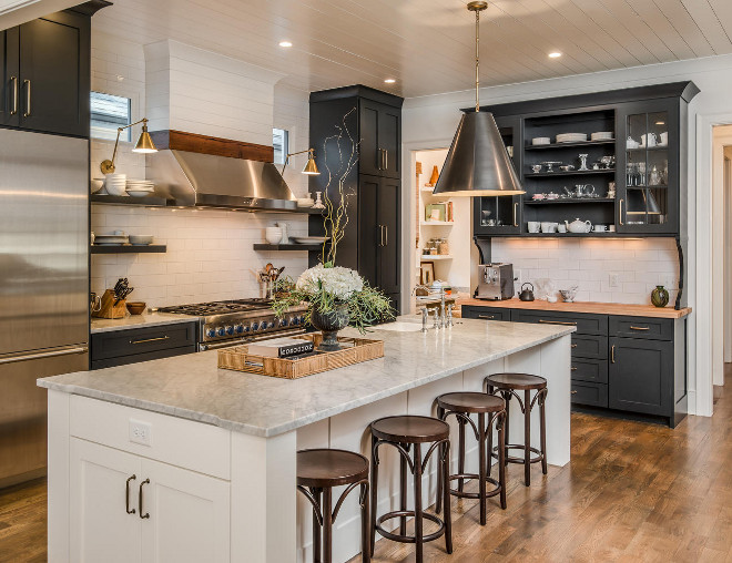 Black and white kitchen. Kitchen with black perimeter cabinets and white white island and shiplap backsplash and shiplap ceiling #Blackandwhitekitchen #Kitchen #blackperimetercabinets #whiteisland #shiplap #shiplapbacksplash #shiplapceiling Domaine Development
