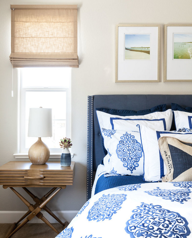 Blue and white Bedding. pottery barn duvet covers, with the medallion one and the solid white with navy banding under it. The solid blue blanket & solid blue shams are Ralph Lauren. Wall color is Coventry Gray (HC-169) by Benjamin Moore. #Wall #color #CoventryGray #HC169 #BenjaminMoore #blueandwhite #bedding Juxtaposed Interiors