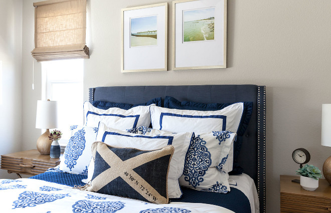 Blue and white bedding with navy bed. Coastal chic bedroom with Blue and white bedding and navy bed. #Coastal #bedroom #Blueandwhite #bedding #navybed Juxtaposed Interiors