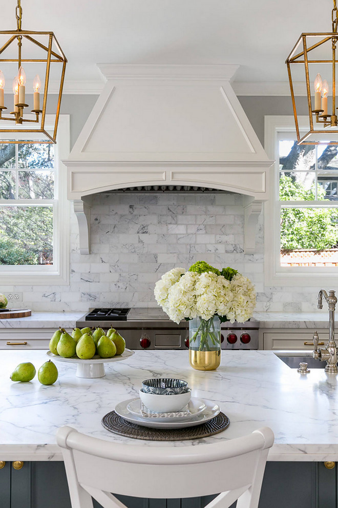 Cararra marble. Kitchen Cararra marble. Cararra marble. The countertop is a slab of honed Cararra marble. The backsplash tile is a 3 x 6 honed Cararra marble tile. Walker Zanger Cararra marble. #Cararramarble Christine Sheldon Design