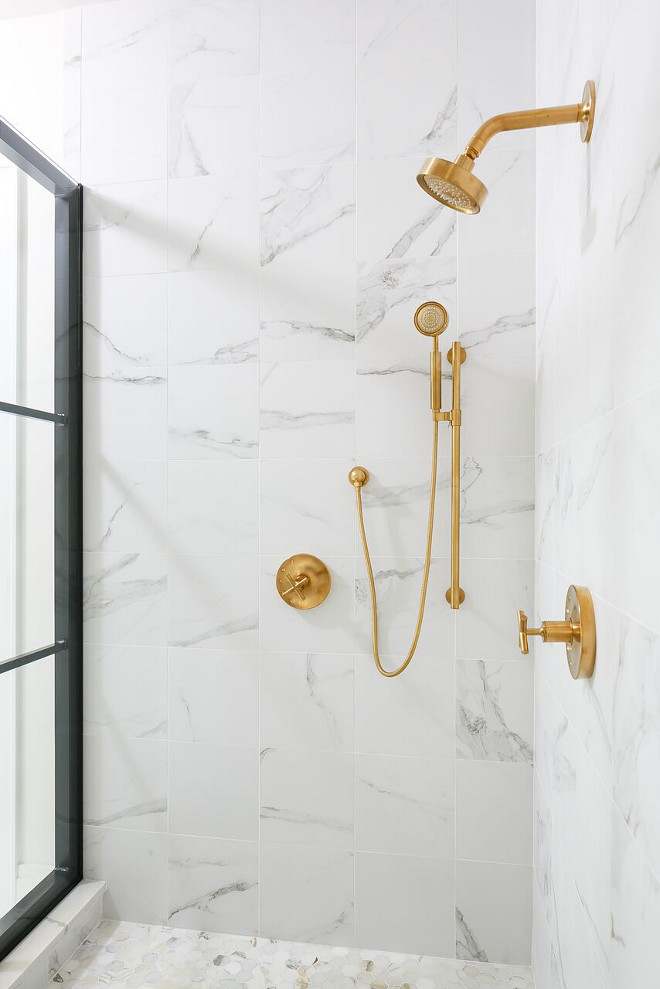 Carrara Marble Shower with Kohler Purist Brass Shower Faucet. I love the contrast of elements found in this bathroom! Notice the brass shower fixtures with the Carrara marble tile and the black shower frame. Flooring is a marble hex tile. Carrara Marble Shower Tile with Kohler Purist Brass Shower Faucet. Carrara Marble Shower with Kohler Purist Brass Shower Faucet #CarraraMarble #CarraraMarbleShower #CarraraMarbleShowerTile #showertile #Kohler #Purist #Brass #Shower #Faucet Ramage Company