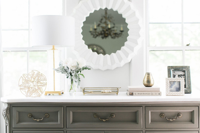 Console Vignette Ideas. The dresser was my mother's. I painted it a grey chalk paint and went to the remnant yard to find a piece of rhino quartz for the top. It has a beautiful creamy look to it and was a very inexpensive upgrade. It is topped with a Serena and Lily mirror and lamp from Wayfair. Console Vignette Ideas. Grey Console with neutral Vignette. Console Vignette Ideas #ConsoleVignetteIdeas #console #VignetteIdeas Home Bunch Beautiful Homes of Instagram @finding__lovely