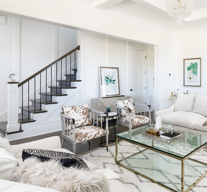 Cowhide chairs. Cowhide chair. The cowhide accent chairs and the brass coffee table are by Caracole. Cowhide accent chair ideas #Cowhidechairs #Cowhidechair Ramage Company. Leslie Cotter Interiors, LLC