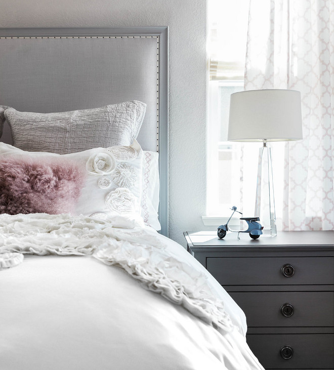 Embroidered Bedding. White and grey bedroom with white bedding. Embroidered Bedding #EmbroideredBedding #Bedding Juxtaposed Interiors