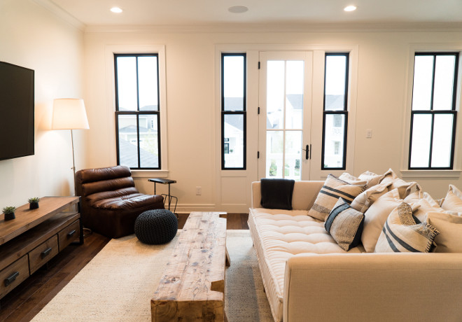 Family Room. Second floor family room. Second floor family room with comfy furniture and black windows #FamilyRoom #Secondfloorfamilyroom #upstairsfamilyroom #comfyfurniture #farmilyroomfurniture #blackwindows Ramage Company