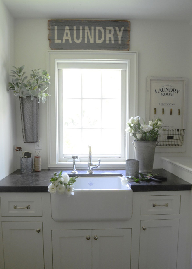 Farmhouse Laundry room. White Farmhouse Laundry room. The laundry room doubles as my flower arranging space and is one of my creative hideaways in our home. Countertop is Belgian Bluestone. #FarmhouseLaundryroom #whiteLaundryroom #whitefarmhouseLaundryroom #Laundryroom Beautiful Homes of Instagram @SanctuaryHomeDecor