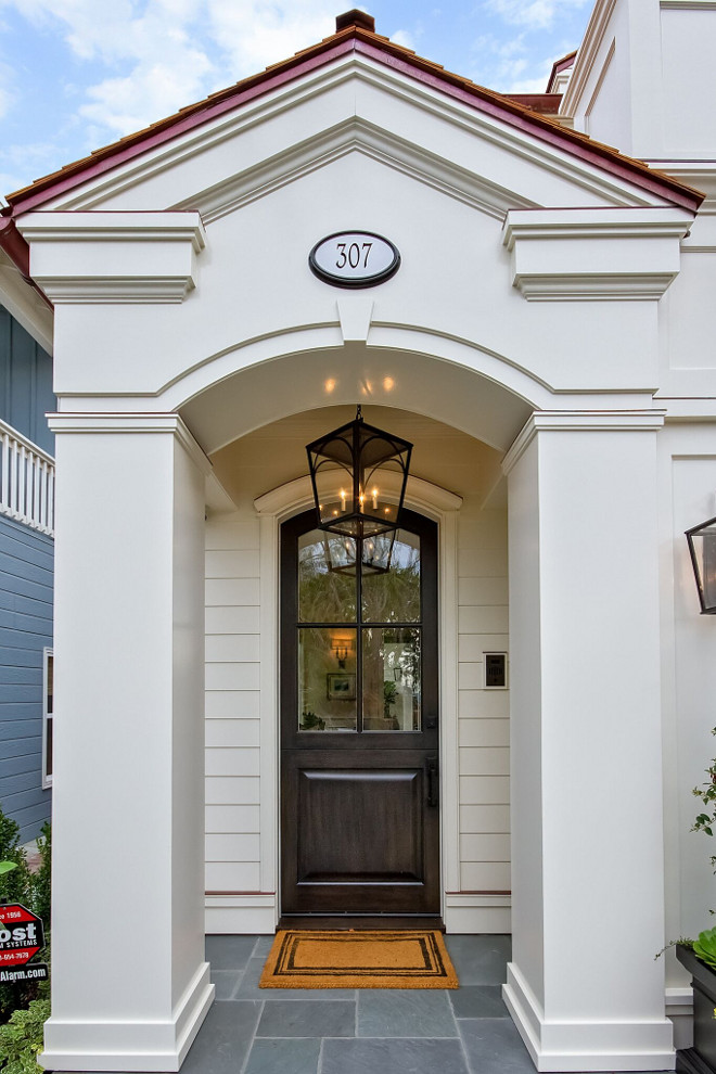 Front Door Entry. Front Entry. This traditional entry features a stunning arched front door. Traditional front entry, front door, house number, glass front door, front door matt, exterior pendant, white siding. Front Door Entry. Front Entry. Traditional front entry, front door, house number, glass front door, front door matt, exterior pendant, white siding #FrontDoor #FrontEntry #Door #Entry #Traditionalentry #tradionalfrontdoor #housenumber #glassfrontdoor #frontdoormatt #doormatt #exteriorpendant #whitesiding Brandon Architects, Inc.