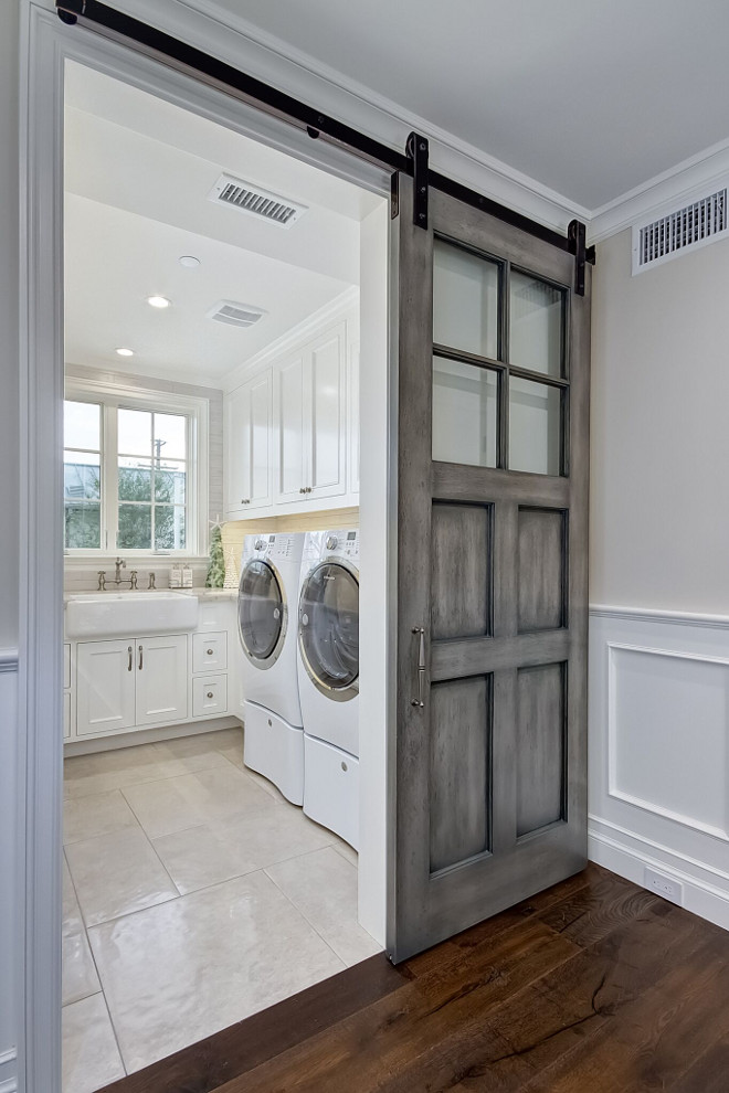 Glazed Barn Door. Laundry room with glazed barn door. Glazed Barn Door Glazed Barn Doors. Glazed Barn Door #GlazedBarnDoor #BarnDoor #slidingBarnDoor Brandon Architects, Inc.
