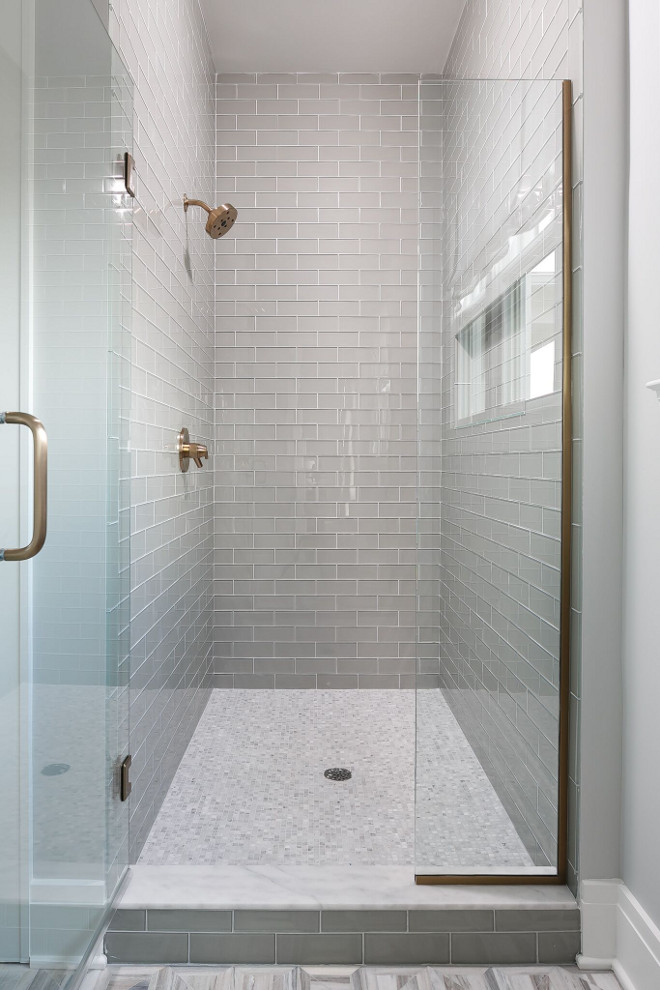 Grey Shower Glass Subway Tile. Neutral Grey Shower Glass Subway Tile. The master shower wall tile is MLW Stone Shiny Frost 3 x 8 glass tile. The shower floor is 5/8 x 5/8 Carrara marble mosaic tile. Grey Shower Glass Subway Tile. Grey Shower Glass Subway Tile #GreyShowerTile #GreyGlassSubwayTile Ramage Company. Leslie Cotter Interiors, LLC