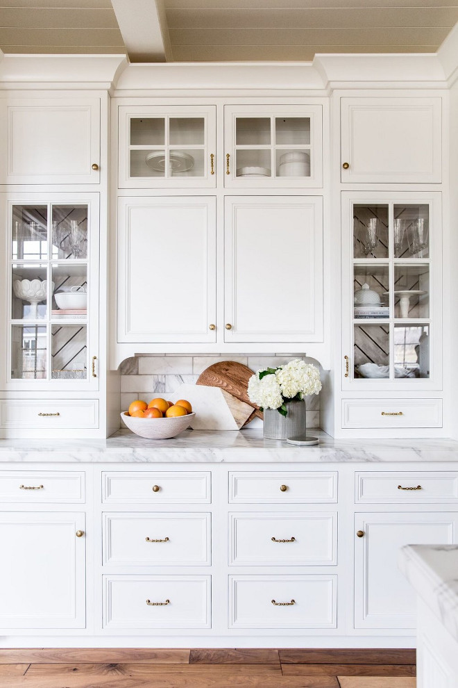 Kitchen Buffet Cabinet with white marble, brass hardware, stacked cabinets with glass doors and custom cabinet trim #KitchenBuffetCabinet #Kitchen #BuffetCabinet #KitchenCabinet #whitemarble #brasshardware #stackedcabinets #cabinetglassdoor #customcabinettrim Pink Peonies Rachel Parcell's Kitchen