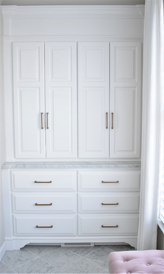 Linen Closet Doors with Brass Hardware and Carrera Marble. Opposite the vanity we had a small space that really wasn't going to be used well so we had a custom storage dresser made again adding the all important storage but making it look like a beautiful piece of furniture. Linen Closet Doors with Brass Hardware and Carrera Marble. Linen Closet Doors with Brass Hardware and Carrera Marble. Linen Closet Doors with Brass Hardware and Carrera Marble #LinenCloset #LinenClosetDoors #Brass #Hardware #CarreraMarble Kate Abt Design