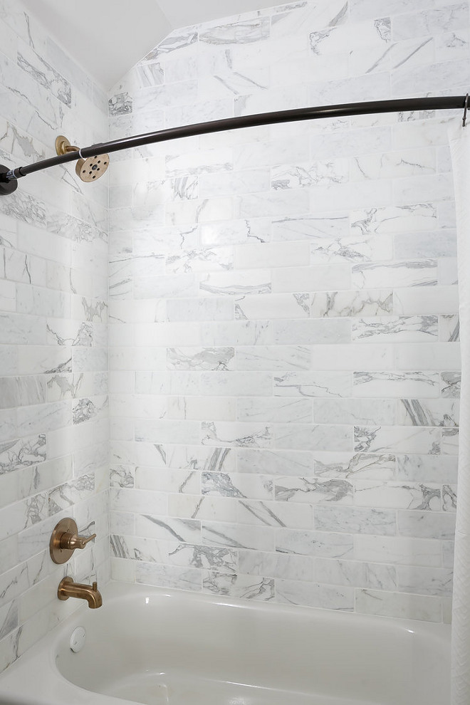 Marble Tile. Shower Marble Tile. Shower marble tile is The wall tile is New Ravenna Bricks 4 x 12 Calacatta Marble Timeworn. #marble #tile #newravenna #calacatta #showertile Ramage Company Leslie Cotter Interiors, LLC