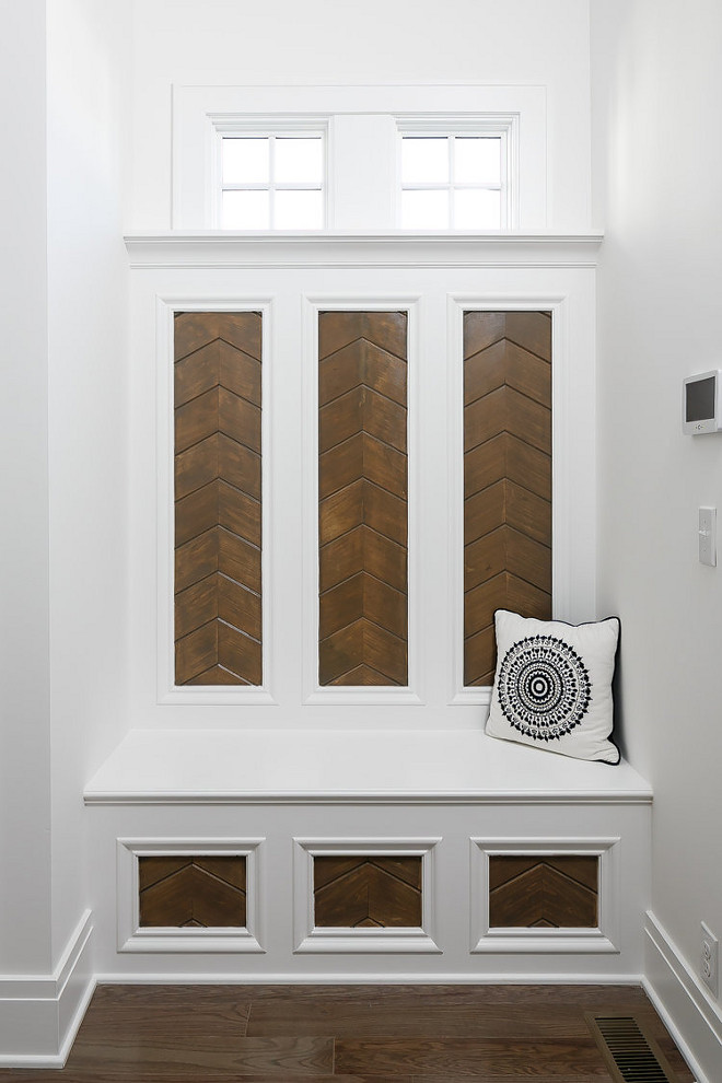 Mudroom. The mudroom built in is a custom design with stained inset chevron paneling. #mudroom #chevron #chevronpaneling #chevroninset Ramage Company. Leslie Cotter Interiors, LLC