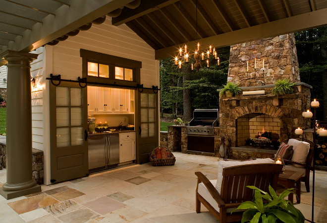 Outdoor Kitchen. Outdoor Fireplace. Patio with outdoor kitchen and outdoor fireplace. The trim and sliding barn doors paint color is Benjamin Moore HC-100 Gloucester Sage #OutdoorKitchen #outdoors #OutdoorFireplace #Patio #slidingbarndoors #barndoors #paintcolor #BenjaminMooreHC100GloucesterSage Rill Architects