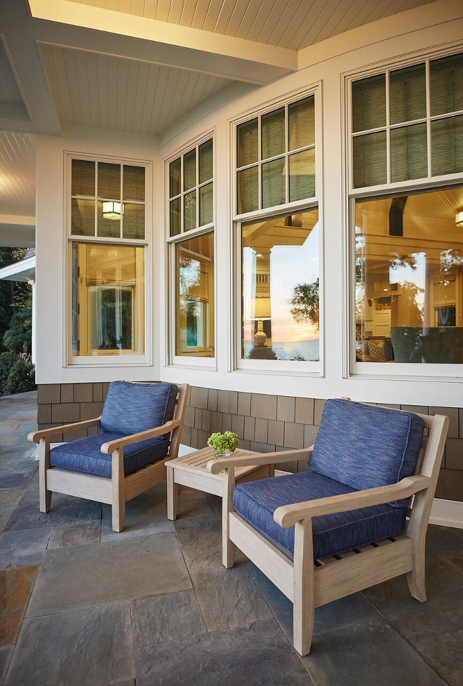 Porch Chairs. Porch Chair Ideas. Porch with bluestone tile and a pair of outdoor chairs. #porch #bluestone #porchchairs #chairs #outdoorchairs Benchmark Wood & Design Studios - Mike Schaap Builders