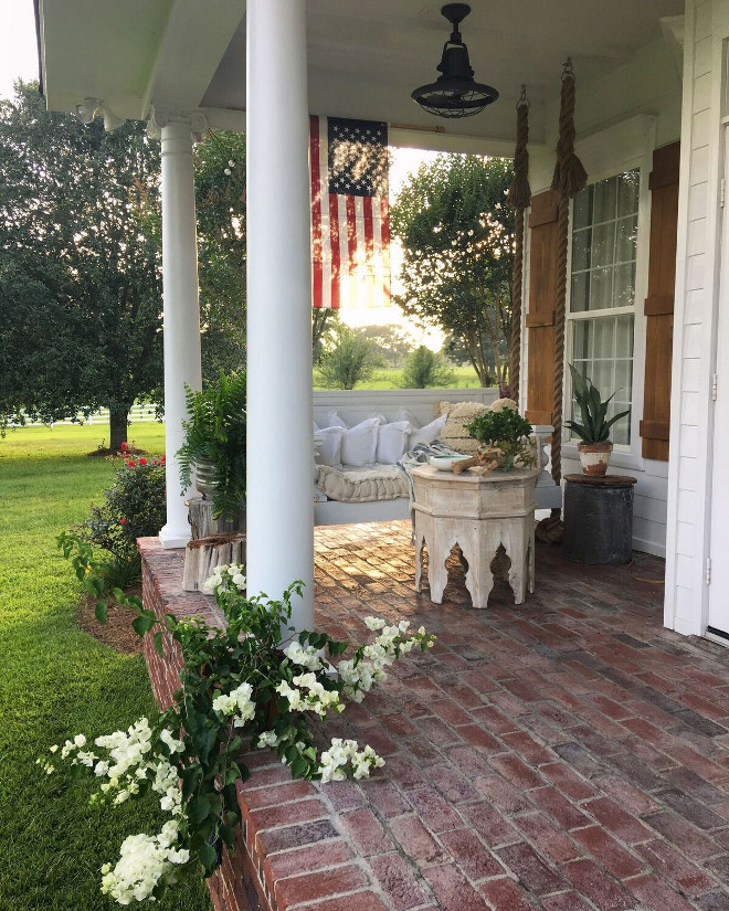 Porch Swing. Porch Swing with rope hangers. Rope Porch Swing. Porch with brick flooring and swing daybed with rope hangers. #porch #swing #swingdaybed #ropeswing #ropedaybed #porch #porchswing