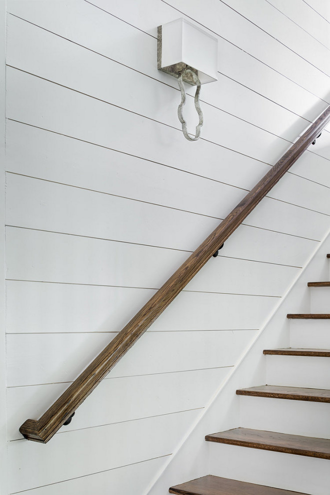 Shiplap Stair paneling with stained oak handrail. Staircase features shiplap paneling, stained oak handrail and oak stair treads. Shiplap Stair paneling ideas. Diy Shiplap Stair paneling. Shiplap Stair paneling with stained oak railing ideas. Shiplap Stair paneling with stained oak handrail. Shiplap Stair paneling with stained oak railing #ShiplapStairpaneling #stainedoakrailing #oakrailing #oakhandrail #handrail ##ShiplapStair #shiplappaneling #oakstairtreads #staitrtreads Willow Homes