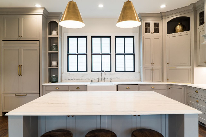 Soft Grey Kitchen Cabinet Paint Color Benjamin Moore Cape May Cobblestone Grey Cabinets are Maple with Inset doors and brass hardware. Countertop and backsplash is Danby Marble Honed. #SoftGreyKitchenCabinetPaintColor #SoftGreyKitchen #GreyCabinetPaintColor #BenjaminMooreCapeMayCobblestoneGrey Ramage Company