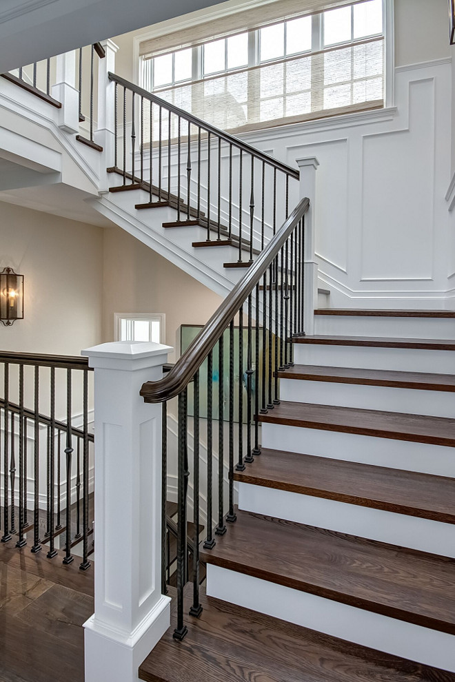 Staircase wood treads. wood treads. Staircase wood tread ideas. Staircase features wood treads and wrought iron spindles #Staircase #woodtreads #wroughtiron #spindles Brandon Architects, Inc.