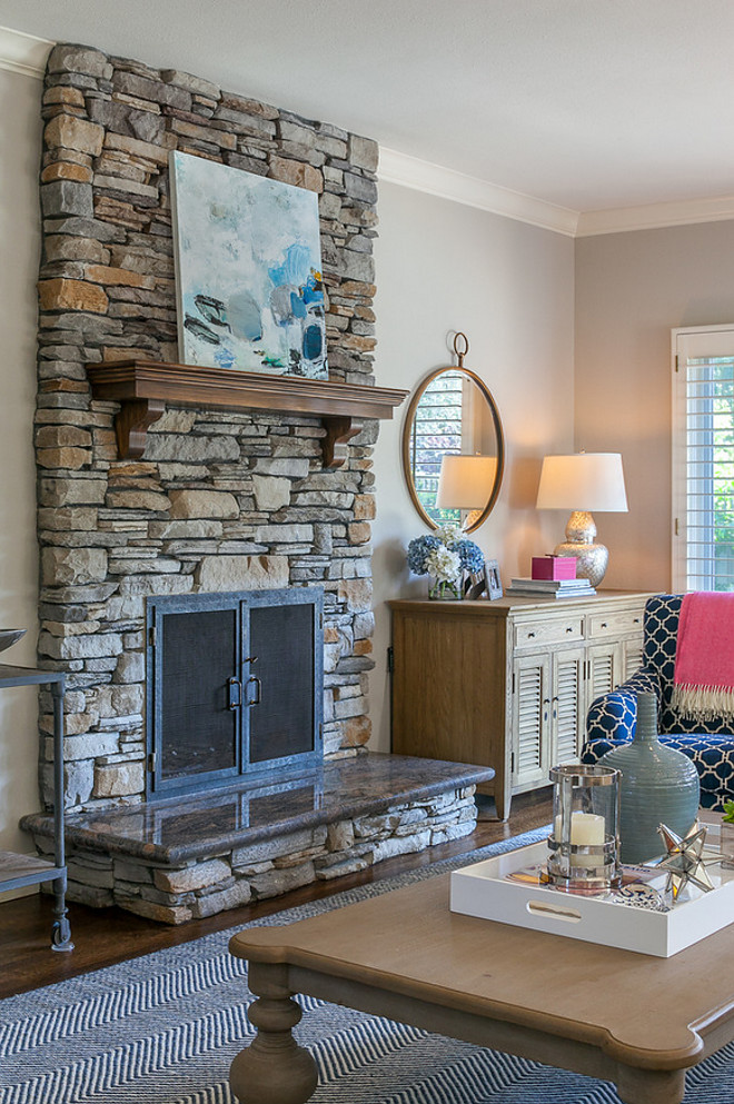 Stone Fireplace. Stone fireplace. This stacked stone fireplace features a granite slab at the ledge. Stacked stone fireplace and granite at the ledge. Stone Fireplace. Stone fireplace. Stacked stone fireplace and granite at the ledge #StoneFireplace #Stonefireplace #Stackedstonefireplace #granite #fireplaceledge Christine Sheldon Design
