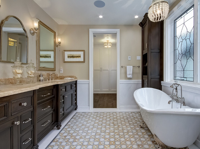 Traditional Bathroom Design. Traditional Bathroom Design Ideas. The master bathroom has a more traditional approach with dark stained cabinets, marble countertop and a clawfoot tub. Traditional Bathroom Design #TraditionalBathroom #TraditionalBathroomDesign Brandon Architects, Inc.