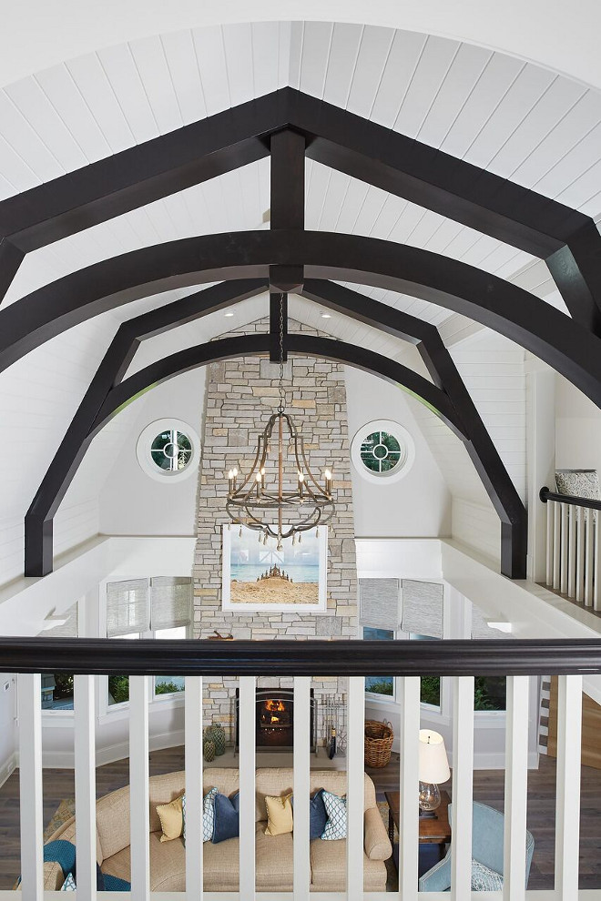 Vaulted Ceiling with Dark Beams and tongue and groove paneling. Floor to ceiling stone fireplace complements the Vaulted Ceiling with Dark Beams and tongue and groove paneling. Vaulted Ceiling with Dark Beams and tongue and groove paneling. Floor to ceiling stone fireplace complements the Vaulted Ceiling with Dark Beams and tongue and groove paneling ideas #VaultedCeiling #DarkBeams #tongueandgrooveceiling #tongueandgroovepaneling #Floortoceilingfireplace #stonefireplace #VaultedCeilings #VaultedCeilingDarkBeams #tongueandgroovepaneling Benchmark Wood & Design Studios - Mike Schaap Builders