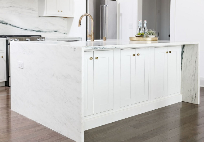 Waterfall marble island. The waterfall style kitchen island features Arabescato Danby Marble #waterfallisland #waterfallkitchenisland #kitchenisland #ArabescatoDanbyMarble Ramage Company. Leslie Cotter Interiors, LLC
