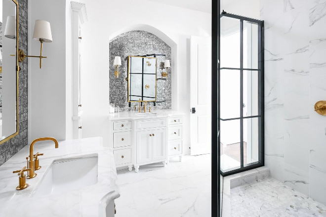 White Bathroom with Black Shower Frame. The master bathroom mixes different elements in a glamorous way. It features white marble, antique mirror subway tile backsplash, brass fixtures and black famed shower doors. White Bathroom with Black Shower Frame Ideas. White Bathroom with Black Shower Frame #WhiteBathroom #BlackShowerFrame #WhiteBathroomBlackShowerFrame #BlackShowerFrameIdeas Ramage Company