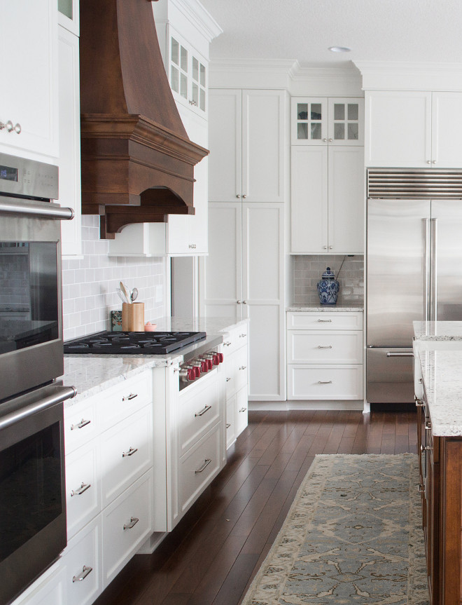 White Kitchen with Stained Wood Hood. White Kitchen with Stained Walnut Wood Hood Ideas. White Kitchen with Stained Wood Hood. White Kitchen with Stained Wood Hood #WhiteKitchen #StainedWoodHood #WoodHood #walnut #walnutkitchen Bria Hammel Interiors