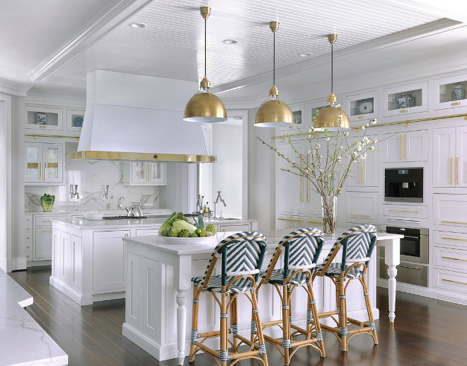 White Kitchen with brass. White kitchen with lots of brass! Brass hardware, brass hood details and brass lighting #whitekitchen #hamptonskitchen #whitekitchenbrass #kitchenbrass #brasshardware #brasshood #brasslighting Mitchell Wall Architecture & Design