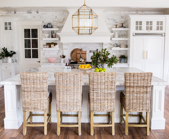 White Kitchen with farmhouse inspired decor. Rachel Parcell's kitchen - a modern classic white kitchen, featuring white cabinets, lots of brass, and marble - gets a glamorous version of a farmhouse style. White Kitchen with farmhouse inspired decor ideas. White Kitchen with farmhouse inspired decorating ideas #WhiteKitchen #farmhouseinspireddecor #WhiteKitchenfarmhousedecor #Kitchenfarmhousedecor #farmhousedecor Pink Peonies Rachel Parcell's Kitchen Pink Peonies Rachel Parcell's Kitchen