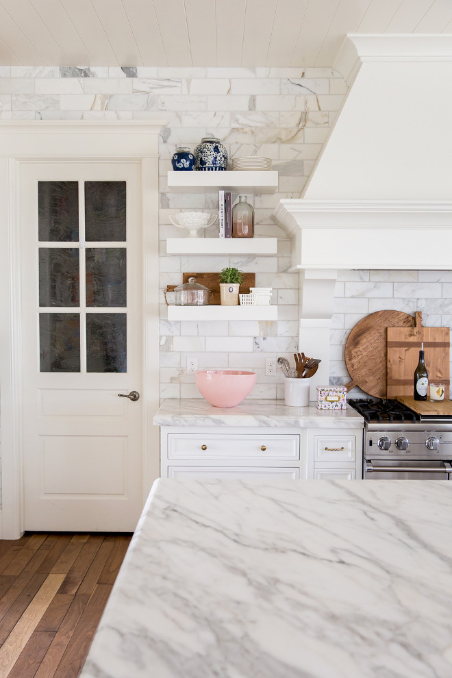 White Kitchen with lots of white marble - white marble countertops and white marble backsplash tile. This white kitchen is all about white marble - white marble countertops and white marble backsplash tile. Also, notice the pantry door on the left. White Kitchen with lots of white marble - white marble countertops and white marble backsplash tile #WhiteKitchen #kitchen #whitemarble #whitemarblecountertop #whitemarblebacksplashtile #marblebacksplashtile Pink Peonies Rachel Parcell's Kitchen