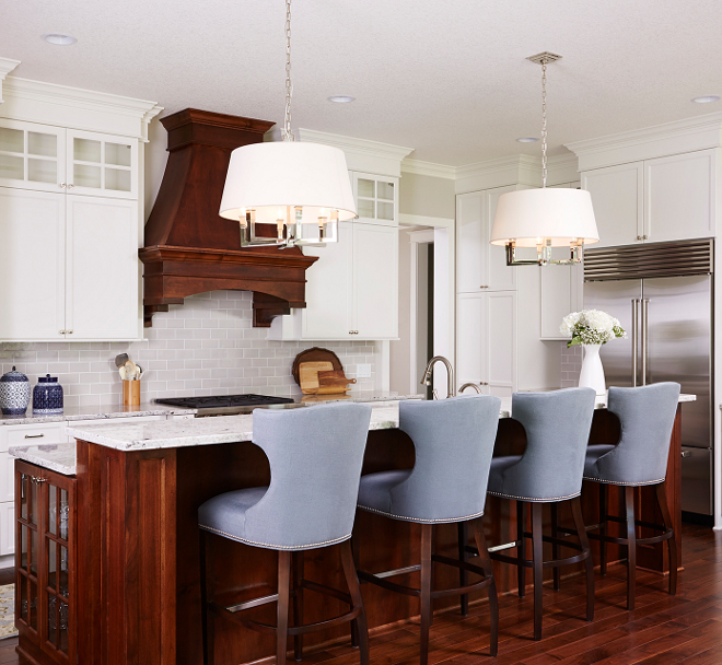 White kitchen with walnut hood and walnut island. This classic white kitchen combines stain and enameled cabinetry. White kitchen with walnut hood and walnut island ideas. White kitchen with walnut hood and walnut island color #Whitekitchen #walnuthood #walnutisland #walnutkitchenisland Bria Hammel Interiors
