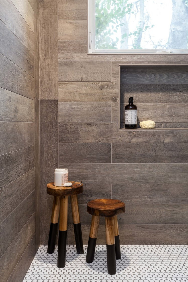 Wood-looking Tile. Wood-looking Shower Tile. According to the designer, the shower was designed to replicate the side of an old barn. Wall tiles are also Walker Zanger. Wood-looking Shower Tile Ideas. Wood-looking Shower Tile and penny floor tile. Wood-looking Shower # Woodlookingtile #ShowerTile #pennytile #WalkerZanger Juxtaposed Interiors