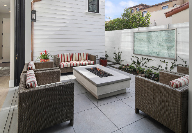 A courtyard with fire pit off the main living space offers the perfect escape for a glass of wine at the end of a long day. Patterson Custom Homes