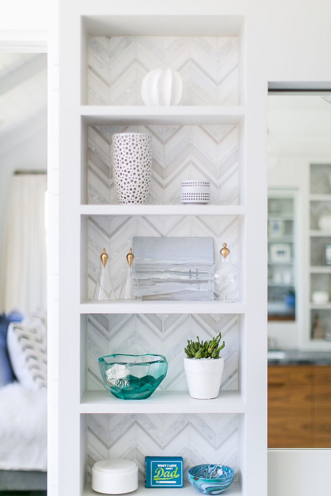 Bathroom Shelves with Marble Herringbone Tile Back. Bathroom features built-in shelves with marble herringbone tile. Bathroom Shelves with Marble Herringbone Back. Bathroom Shelves with Marble Herringbone Tile Back. Bathroom Shelves with Marble Herringbone Tile Back #BathroomShelves #MarbleHerringboneTile Patterson Custom Homes