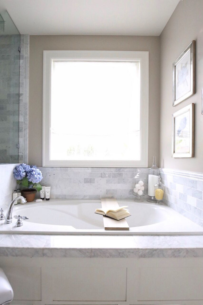 Bathtub Marble Tile. Bathtub Marble Tile. Bathtub Marble Tile. Carrera marble floors, and tile surrounds the walls and tub, giving the bathroom a spacious and airy feel. Bathtub Marble Tile. Bathtub Marble Tile #BathtubMarbleTile Home Bunch's Beautiful Homes of Instagram @cambridgehomecompany