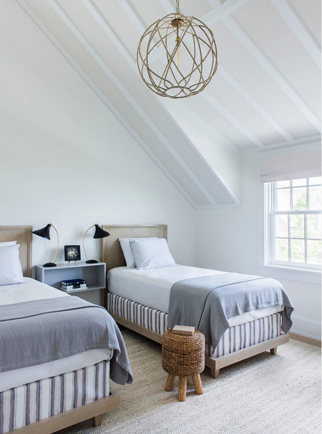Beach house guest bedroom. Sloped bedroom ceiling. Beach house guest bedroom. Sloped bedroom ceiling ideas #Beachhouse #guestbedroom #Slopedceiling #bedroom Cynthia Hayes Interior Design