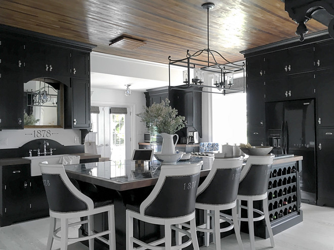 Black Farmhouse Kitchen. Black Farmhouse Kitchen. I designed the cabinetry to give a sense of history while also bringing a bit of drama. Curved elements inspired by the hoop top front door are repeated throughout this space. Some examples of this are curvy corbels, backplates for knobs, globe like pendants and a half moon arch over the sink. Black Farmhouse Kitchen #BlackFarmhouseKitchen #FarmhouseKitchen #Blackkitchen Part of the joy living in an old home brings is the connection to living history. Home Bunch's Beautiful Homes of Instagram Cynthia Weber Design @Cynthia_Weber_Design