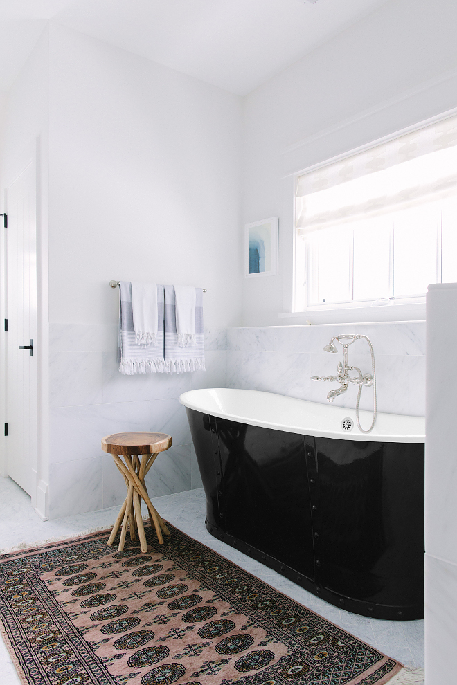 Black Rivet Tub. Black Rivet Freestanding Tub. Bransdale 'rivet' freestanding Cast Iron Roll Top 'Bateau' Bath. Bathroom features a black rivet tub and a kilim runner. Kate Marker Interiors