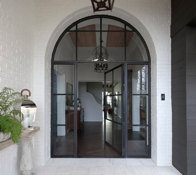 Black Steel Front Door. Arched Black Steel Front Door. Black Steel Front Door and sidelights #BlackSteelFrontDoor #BlackSteelDoor Christopher Architecture & Interiors