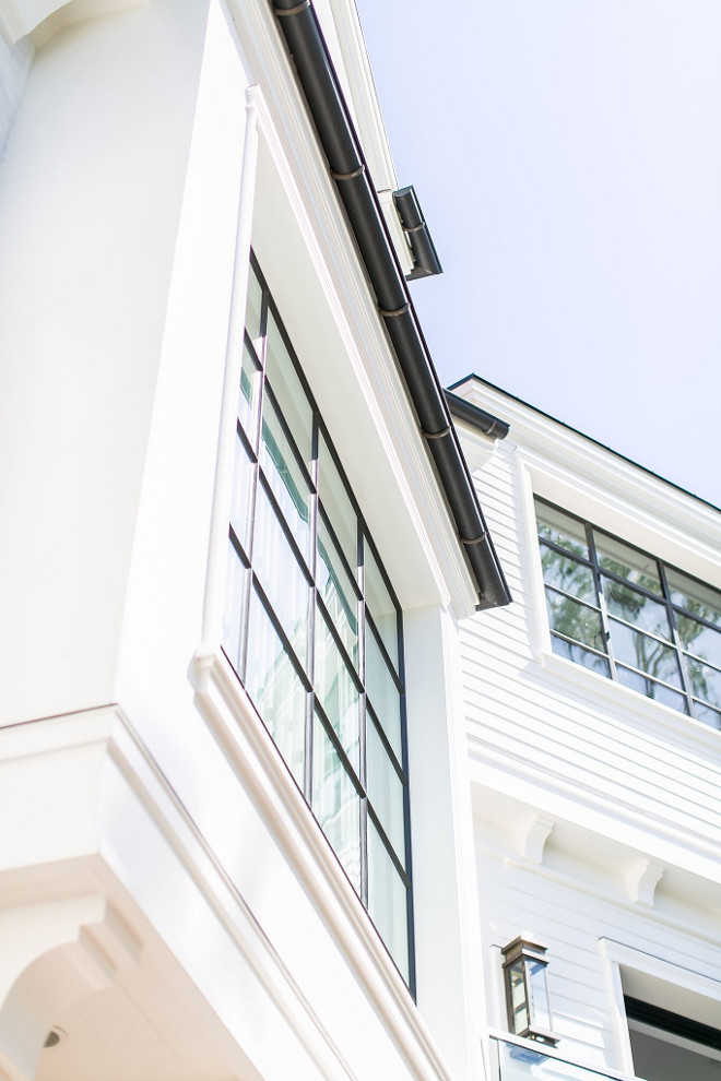 Black Steel Windows. White home with black steel windows and black gutters. Black Steel Windows. White home with black steel windows and black gutters. Black Steel Windows. White home with black steel windows and black gutters #BlackSteelWindows #Whitehome #blackwindows #blackgutters Patterson Custom Homes
