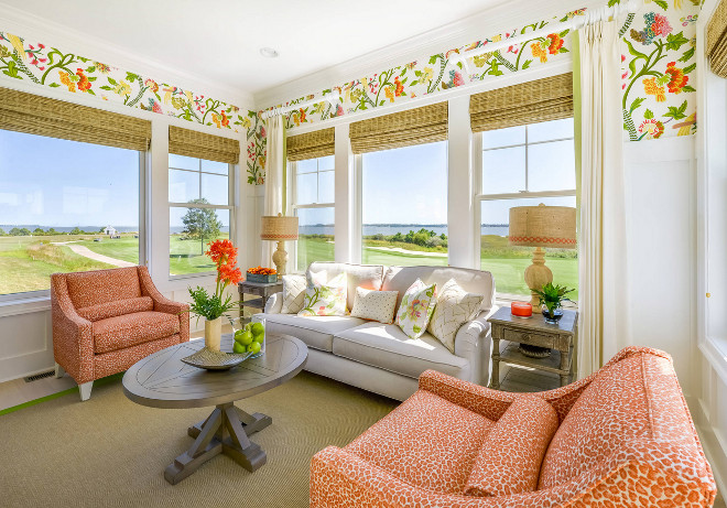 Cheerful sunroom with ocean view. Featuring wainscoting and a floral wallpaper by Thibaut, this sunroom is all about being happy and enjoying that ocean view! Wallpaper above wainscoting is Thibaut Janta Bazaar in Brights. Cheerful sunroom with ocean view. Cheerful sunroom with ocean view Cheerful sunroom with ocean view #Cheerful #sunroom #oceanview Echelon Interiors