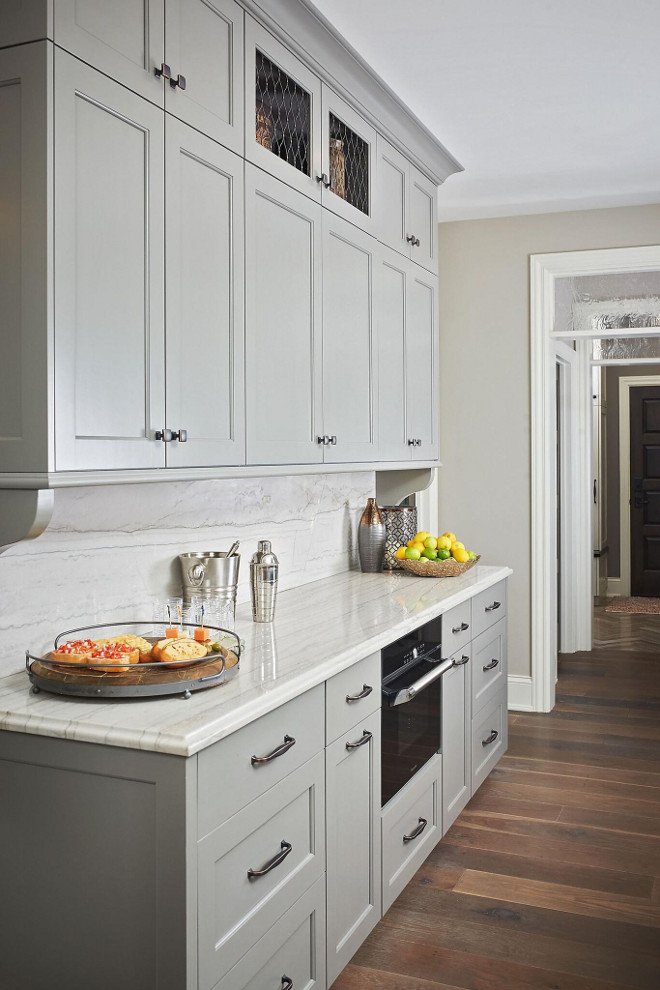 Chelsea Gray HC-168 Benjamin Moore. Chelsea Gray HC-168 Benjamin Moore Paint Color. Countertop and Backsplash White Macaubas quartzite. Chelsea Gray HC-168 Benjamin Moore Kitchen Cabinet Paint Color Chelsea Gray HC-168 Benjamin Moore #ChelseaGrayHC168BenjaminMoore #ChelseaGrayHC168 #ChelseaGrayBenjaminMoore #ChelseaGray #HC168 #BenjaminMoore #kitchen #cabinet #paintcolor #BenjaminMooregreypaintcolors #BenjaminMoorepaintcolors Mike Schaap Builders