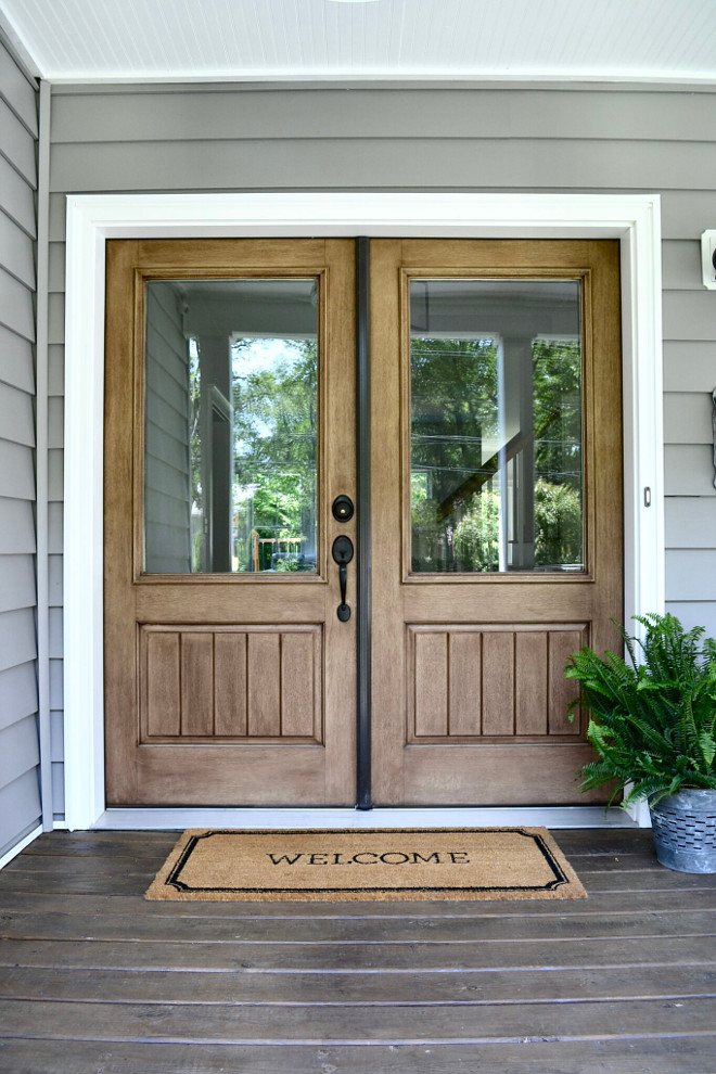 Double Front Doors. One of my favorite features of our entry is our double doors. The wood tones add warmth and character to our porch and we chose the clear glass panes to add extra light to our home. #Doublefrontdoors #wooddoors Home Bunch's Beautiful Homes of Instagram @sweetthreadsco