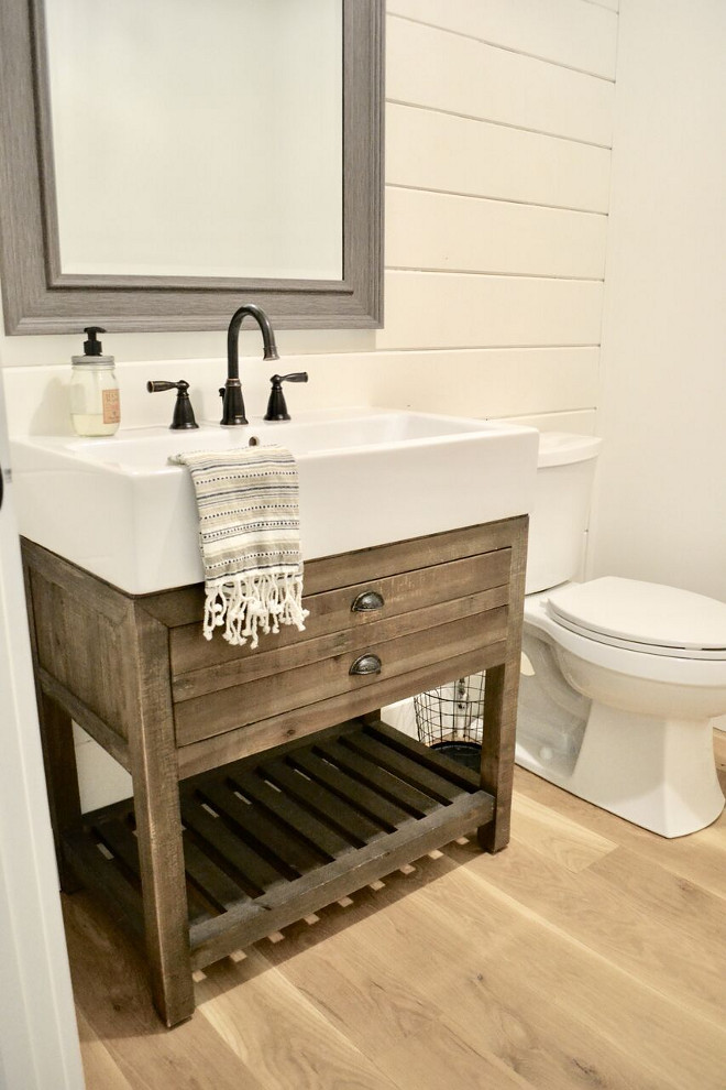 Famrhouse Bathroom. Our guest bathroom on the main level is definitely has some rustic, farmhouse charm with a shiplap wall and wood trough sink. #farmhousebathroom #farmhouse #bathroom Home Bunch's Beautiful Homes of Instagram @sweetthreadsco