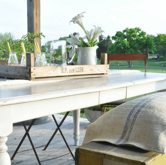 Farmhouse Back Porch Table and bench with burlap cushion. Home Bunch's Beautiful Homes of Instagram @becky.cunningham.home
