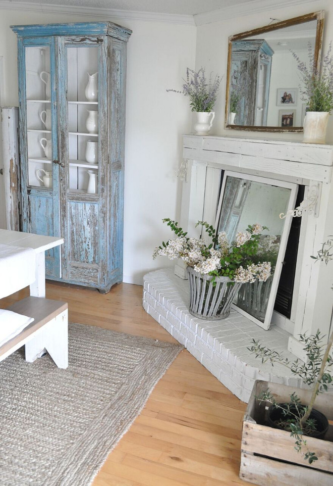 Farmhouse Fireplace. Farmhouse Fireplace. Farmhouse Fireplace. We designed and built the mantle from reclaimed wood. It's painted in Cotton Fluff by BEHR. Farmhouse Fireplace. Farmhouse Fireplace #FarmhouseFireplace Home Bunch's Beautiful Homes of Instagram @becky.cunningham.home